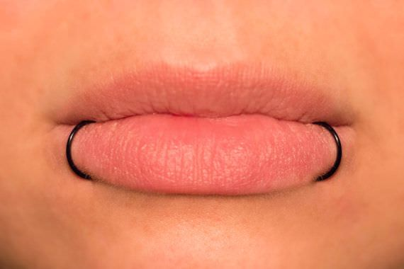 Snake bites piercing guide images for Lip tattoo cost