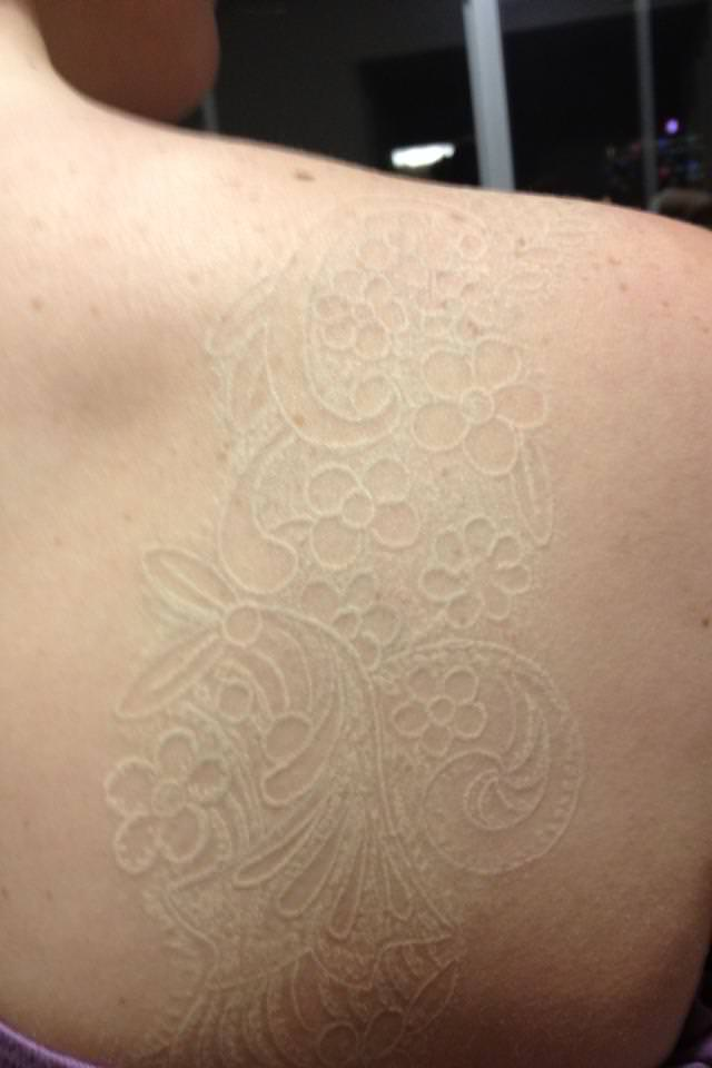 White Ink Tattoo On Light Skin